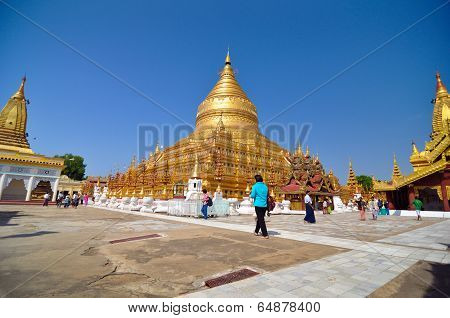 Nzaung-u, Myanmar - October 9: Tourists Sightseeing The Shwezigon Pagoda