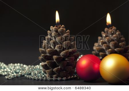 Two Candles As A Candle With Christmas-tree Decorations