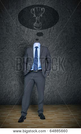 Composite image of headless businessman with winners cup in speech bubble in grey room