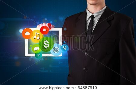 Young businessman presenting colorful modern signs
