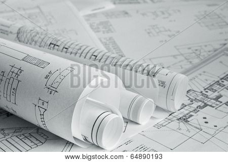 Architect rolls and plans blueprint