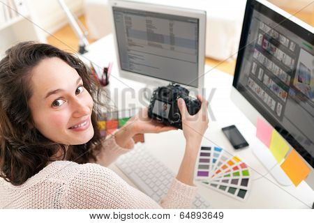Young Woman Photographer Working In Her Office