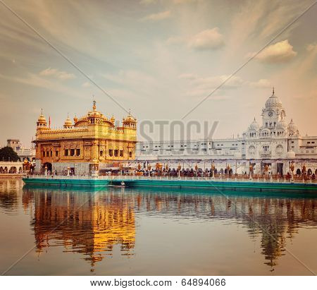 Vintage retro effect filtered hipster style travel image of Sikh gurdwara Golden Temple (Harmandir Sahib). Amritsar, Punjab, India