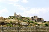 picture of jainism  - a temple under construction on top of a hill - JPG