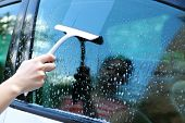 image of window washing  - Hand washing car window - JPG