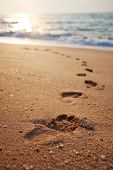 stock photo of footprint  - Footprints on the beach sand - JPG