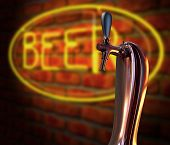 stock photo of tapping  - A regular chrome draught beer tap on a facebrick wall background with a neon beer sign illuminated in the background - JPG