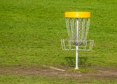 stock photo of frisbee  - Frisbee golf basket on the green grass - JPG