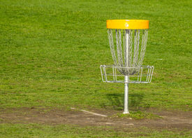 picture of frisbee  - Frisbee golf basket on the green grass - JPG