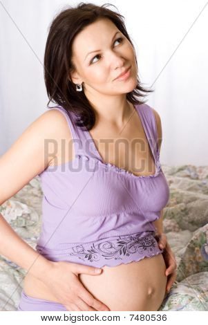 Pregnant Woman  On A Purple