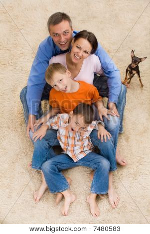 Family And Dog On The Carpet