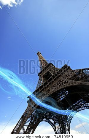 Low angle view of blue streak of lights passing under Eiffel Tower
