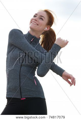 Happy Young Woman Warming Up Before Workout