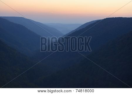 Foggy Valley and Mountains at Twilight