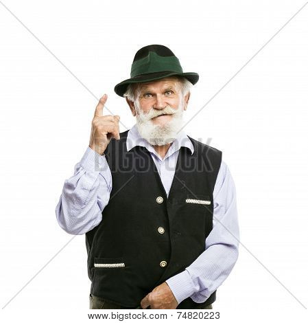 Old bavarian man in hat pointing upwards isolated