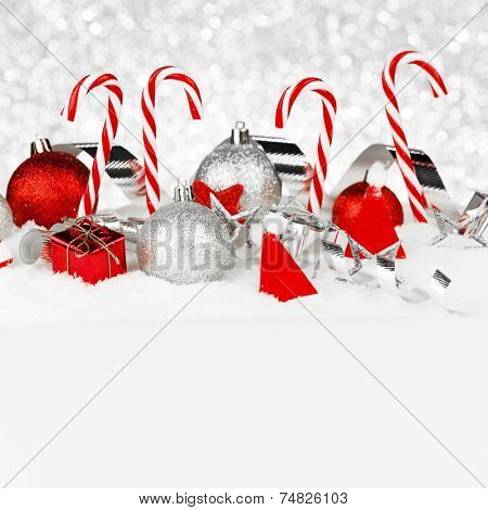 Christmas card with beautiful decorations and candies in snow