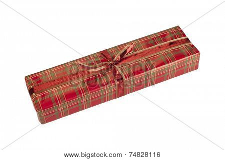 Christmas present in beautiful tartan wrapping on white background