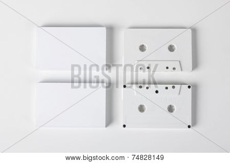 Blank audio cassettes on white background with blank packaging