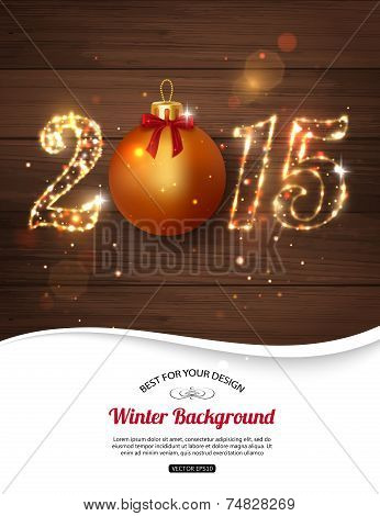 Happy New Year 2015 celebration concept with golden ball over wooden background and place for text.