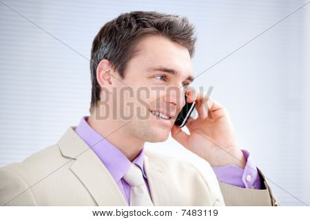 Positive Businessman Talking On Phone