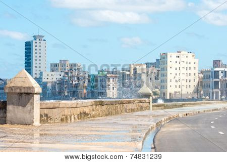 The famous malecon seawall in Havana vith a view of the city skyline