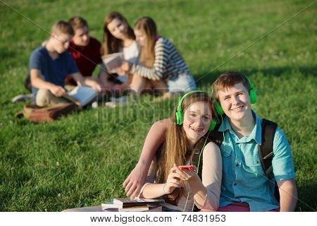 Cute Teens With Earphones