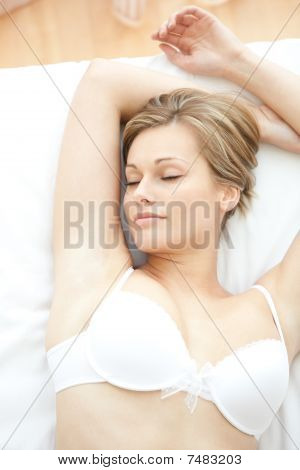 Dreamy Woman In Underwear Lying On Bed