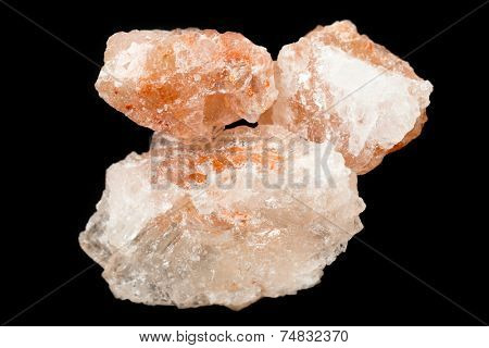 Crystalline Himalayan pink rock salt, a fashionable condiment, over a black background