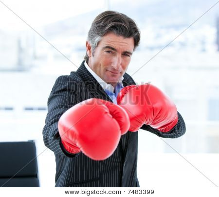 Furious Businessman Wearing Boxing Gloves
