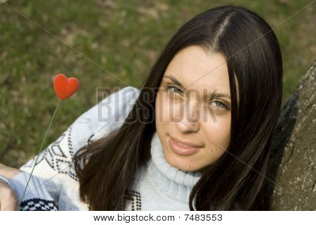 Beautiful girl with a red heart