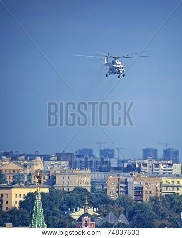 Russian President`s Helicopter In The Air Over Moscow Kremlin Tower