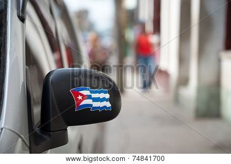 Cuban Flag In The Rearview Mirror Of A Car