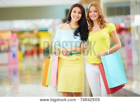 Portrait of beautiful girls in smart casual seeking for new clothes