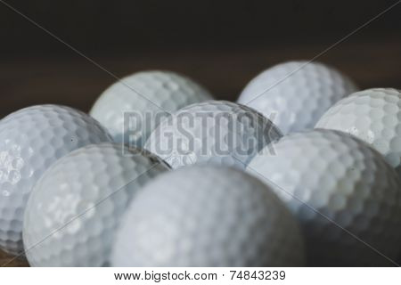Few golf balls on the table
