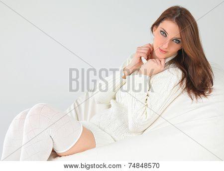 beautiful young woman wearing white sweater