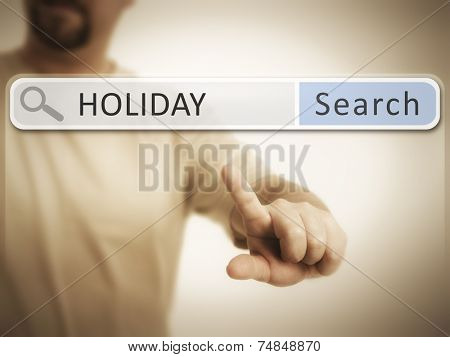 An image of a man who is searching the web after holiday