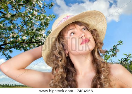 Closeup Portrait Of A Cute Young Woman Wearing A Straw Hat