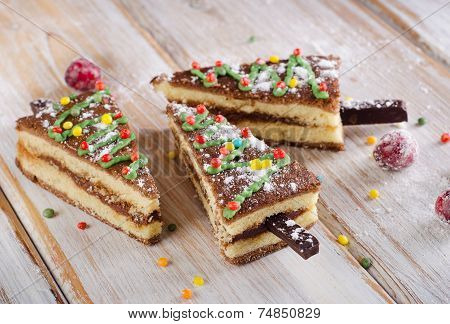 Christmas Tree Made Of  Cake On A Wooden Table .
