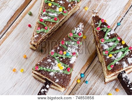 Christmas Tree Made Of  Cake On  Wooden Background .