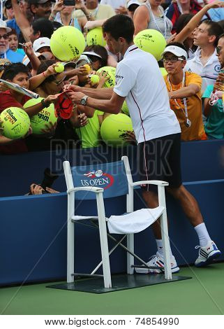 Six times Grand Slam champion Novak Djokovic signing autographs after US Open 2014 match