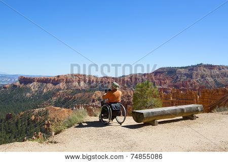 Unidentified handicapped visitor at the rim at Bryce Canyon National Park in Utah