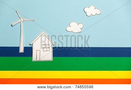 Home model, windmill and clouds on colorful background. Concept of peace and earth
