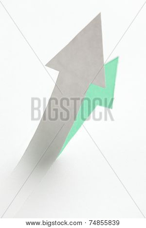 Close up of arrow with shadow growing up, isolated on white. Concept of growing business and development