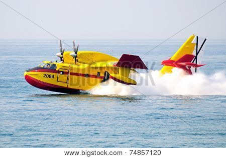 Fire bomber collecting sea water.
