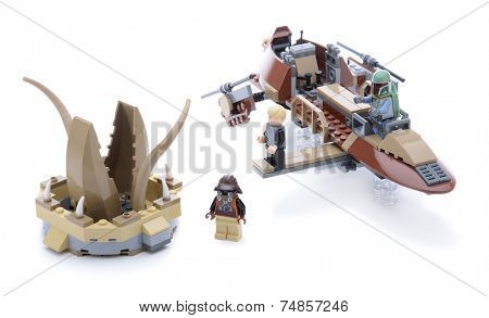 Ankara, Turkey - May 23, 2013: Lego Star Wars Desert Skiff and minifigures Luke Skywalker, Lando Calrissian, Boba Fett and Kithaba isolated on white background.