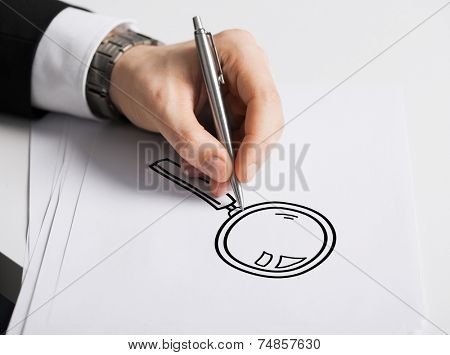 business, marketing, planning and people concept - close up of male hand with pen drawing lens on white paper