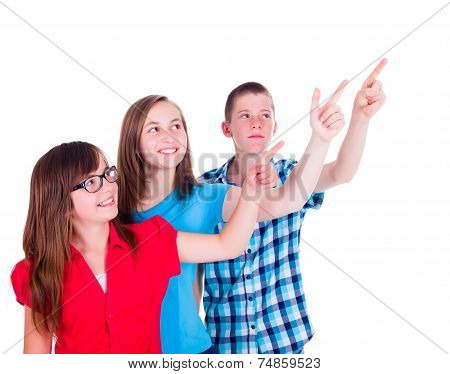 Teenagers Pointing And Looking Up To Copy Space