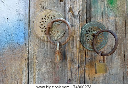 Old Wooden Door with Escutcheons and Padlocks