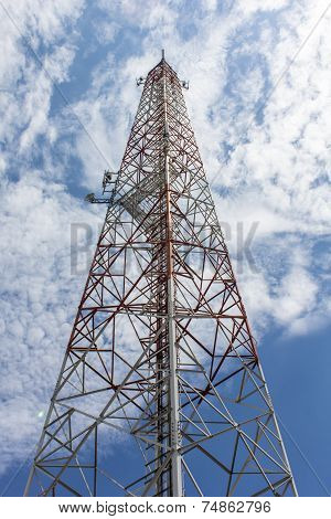 Red And White Tower Of Communications With Beauty Sky