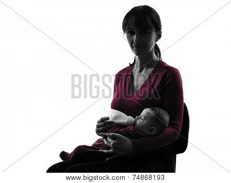 one  woman feeding bottle baby  silhouette on white background